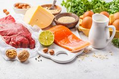 Balanced diet food background. Protein foods: fish, meat, cheese. Balanced diet food background. Protein foods: fish, meat, eggs, cheese, quinoa, nuts on white royalty free stock image