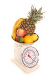 Balanced diet fruit on weighing scales. Cutout Stock Photos