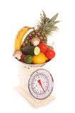 Balanced diet on weighing scales. Balanced diet fruit and vegetables on weighing scales Stock Photos