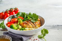 Balanced food concept. Chicken, broccoli and quinoa salad in white bowl, gray background, copy space