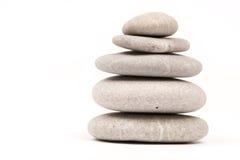 Balanced grey stones over white background Stock Image