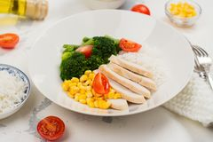 Balanced meal or diet concept. Chicken with rice and vegetables Stock Photography