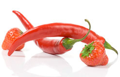 Balanced nutrition - sweet berries and hot peppers Stock Images