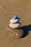 Balanced pebble stack on beach. Composition of the balanced pebbles Royalty Free Stock Photos
