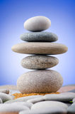 Balanced pebbles on  colour background Stock Photo