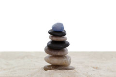 Balanced pebbles on sand Stock Photo