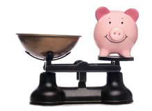 Balanced piggy bank Royalty Free Stock Image