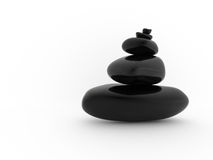 Balanced pile of black stones Royalty Free Stock Image