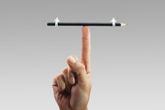 Balanced relationship. Pencil balanced on finger with two paper figures on each end depicting balanced relationship Royalty Free Stock Images