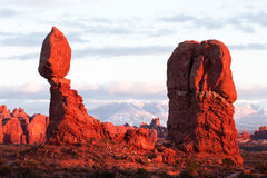 Balanced Rock. At Sunset with La Sal Mountains in Background Royalty Free Stock Photo