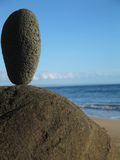 Balanced rock. Balancing a rock on the beach just before sunset in Maui.  perfect backdrop Stock Photography
