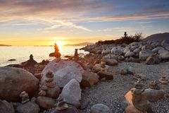 Balanced rock sculptures at English Bay during sunset Royalty Free Stock Photos