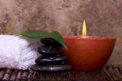 Balanced rocks, candle on bamboo Royalty Free Stock Image