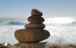 Balanced rocks near the sea. Four pebbles balanced on top of each other Stock Photos