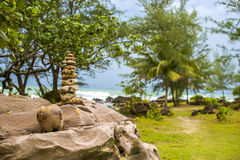 Balanced Rocks Overlooking a Path. Balanced rocks over looking a beautiful beach setting in Vietnam Royalty Free Stock Image