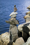 Balanced rocks by sea shore Stock Photography