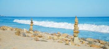 Balanced rocks. Stack of sea rocks balancing by Pacific ocean Royalty Free Stock Photography