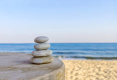 Balanced several Zen stones on blurred beautiful the beach background Royalty Free Stock Images