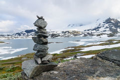 Balanced stack of stones against snowy mountains Royalty Free Stock Photo