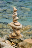 Balanced stone structure on rocky shore Stock Photos