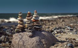 Balanced stone tower at the sunny beach royalty free stock photography