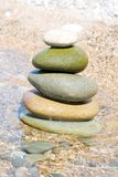 Balanced stones. On the water royalty free stock photography