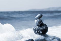Balanced stones. On the water Stock Image