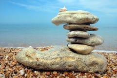 Balanced stones. On sea beach Stock Images