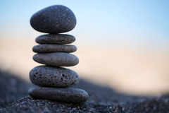 Balanced Stones. Stack of volcanic pebbles on seashore Stock Image
