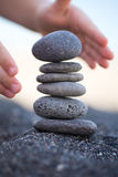 Balanced Stones. Stack of volcanic pebbles on seashore Royalty Free Stock Photo