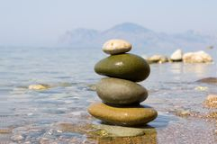 Balanced stones. On the sea stock images