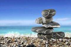 Balanced stones on the beach Royalty Free Stock Photo