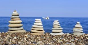 Balanced stones on the beach Stock Photos