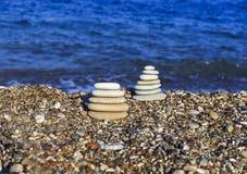 Balanced stones on the beach Stock Photo