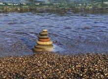 Balanced stones on the beach Royalty Free Stock Photo