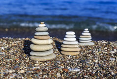 Balanced stones on the beach Royalty Free Stock Photos