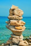 Balanced stones on the beach in the summer Royalty Free Stock Photography