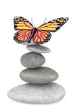 Balanced stones with butterfly Royalty Free Stock Photography