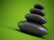 Balanced stones on green Stock Photos