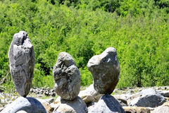 Balanced stones near the caucasus river Royalty Free Stock Image