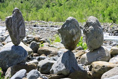 Balanced stones near the caucasus river Stock Image