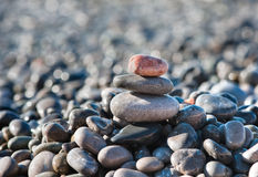 Balanced stones on the sea Stock Images