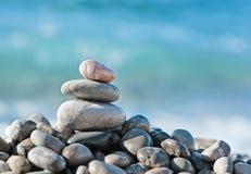 Balanced stones on the sea Stock Photos