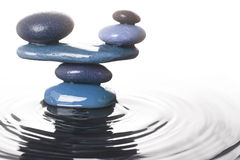 Balanced stones in water. Carefully balanced stones in water Stock Images