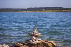 Balanced stones by the water Stock Photography