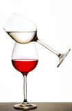 Balanced wine glasses. Two wine glasses balanced on each other with white background Stock Images