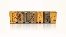 Balancen-Wort-Blockschrift - lokalisierter weißer Hintergrund Stockbild