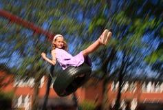 Balanceo de la chica joven Foto de archivo libre de regalías
