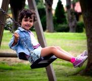 Balanceo de la muchacha Imágenes de archivo libres de regalías