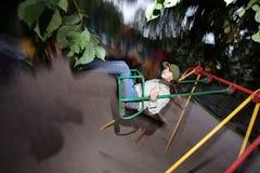 Balanceo de la muchacha Foto de archivo libre de regalías